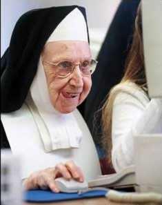 Nun At Computer